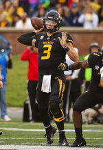 Missouri quarterback Drew Lock throws a pass during the first half of an NCAA college football game against Wyoming, Saturday, Sept. 8, 2018, in Columbia, Mo. (AP Photo/L.G. Patterson)