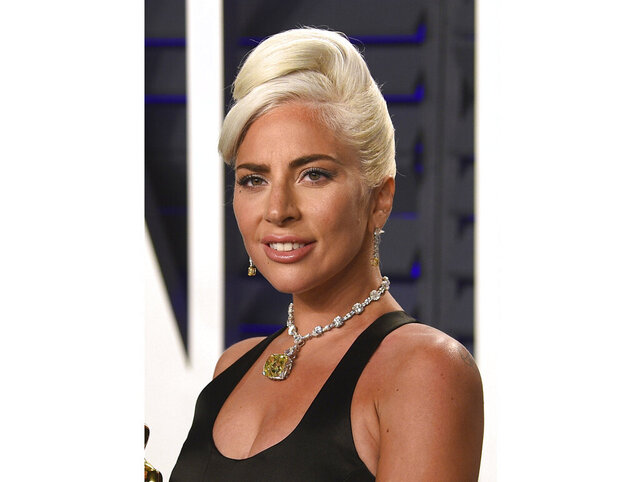 FILE - This Feb. 24, 2019 file photo shows Lady Gaga at the Vanity Fair Oscar Party in Beverly Hills, Calif. Through music, Lady Gaga told those stressing during the coronavirus pandemic to smile and Stevie Wonder encouraged viewers to lean on one another. The A-listers kicked off the two-hour TV special