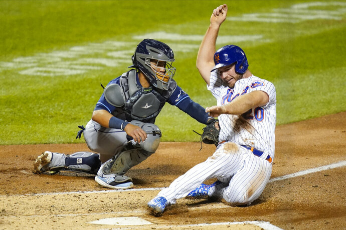 Tampa Bay Rays catcher Michael Perez, left, tags out New York Mets' Pete Alonso at home plate during the second inning of a baseball game Tuesday, Sept. 22, 2020, in New York. (AP Photo/Frank Franklin II)