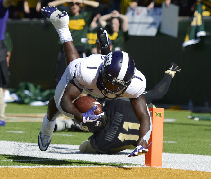 TCU wide receiver Jalen Reagor scores over Baylor cornerback Jameson Houston in the first half of an NCAA college football game, Saturday, Nov. 17, 2018, in Waco, Texas. (Ernesto Garcia/Waco Tribune-Herald via AP)
