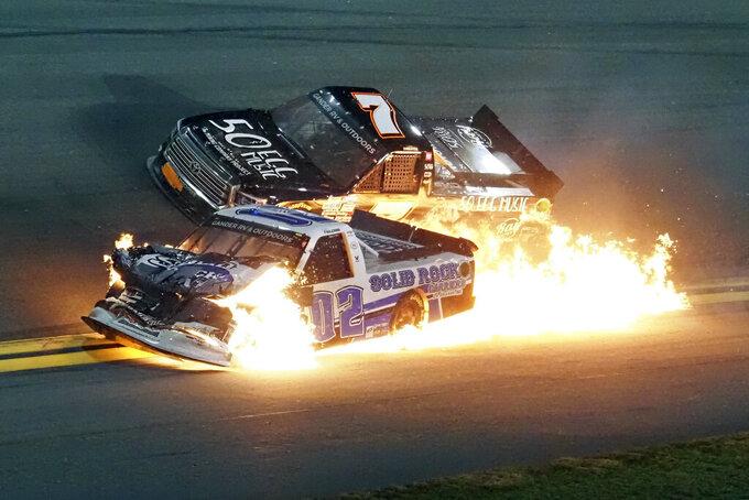Tate Fogleman (02) and Korbin Forrister (7) crash between turns 3 and 4 during the NASCAR Truck Series auto race at Daytona International Speedway, Friday, Feb. 14, 2020, in Daytona Beach, Fla. (AP Photo/Darryl Graham)