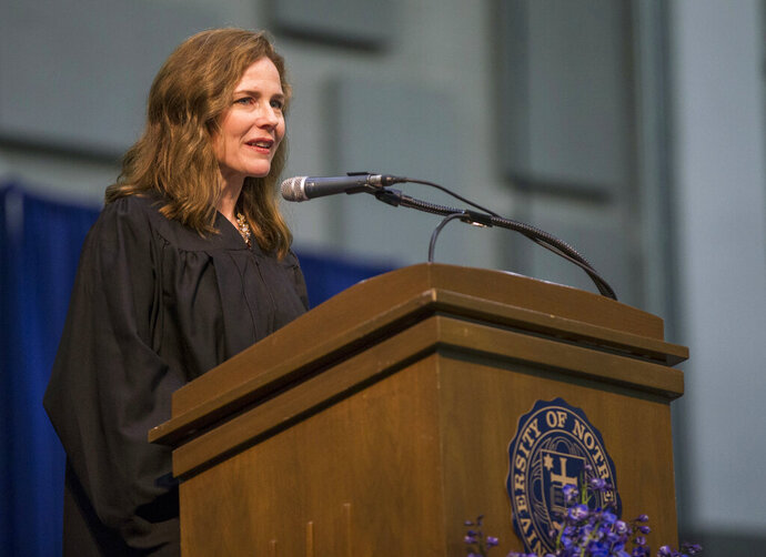 FILE - In this May 19, 2018, file photo, Amy Coney Barrett, United States Court of Appeals for the Seventh Circuit judge, speaks during the University of Notre Dame's Law School commencement ceremony at the university, in South Bend, Ind. Barrett, a front-runner to fill the Supreme Court seat vacated by the death of Justice Ruth Bader Ginsburg, has established herself as a reliable conservative on hot-button legal issues from abortion to gun control. (Robert Franklin/South Bend Tribune via AP, File)