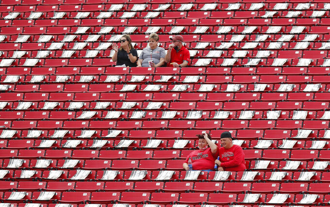 Many seats are blocked off to force social distancing at an NCAA college football game between Texas Tech and Houston Baptist, Saturday, Sept. 12, 2020, in Lubbock, Texas. (AP Photo/Mark Rogers)