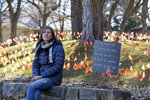 CORRECTS SPELLING OF LAST NAME ON FIRST REFERENCE - Cindy Pollock poses for a portrait in Boise, Idaho, on Wednesday, Feb. 10, 2021. Pollock began planting the tiny flags across her yard — one for each of the more than 1,800 Idahoans killed by COVID-19 — the toll was mostly a number. Until two women she had never met rang her doorbell in tears, seeking a place to mourn the husband and father they had just lost. (AP Photo/Otto Kitsinger)
