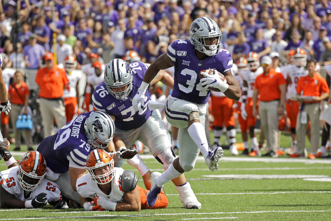 Kansas State running back James Gilbert (34) breaks from the pack to score a touchdown during the first half of an NCAA college football game against Bowling Green Saturday, Sept. 7, 2019, in Manhattan, Kan. (AP Photo/Charlie Riedel)