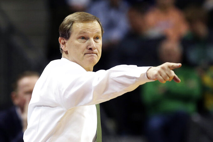 FILE - In this Feb. 27, 2020, file photo, Oregon coach Dana Altman points to the team during the second half of an NCAA college basketball game against Oregon State in Eugene, Ore. Some three weeks to go before the start of the season, and Oregon hadn't yet scrimmaged. The team was already behind with conditioning. The nonconference scheduling was still being sorted out, in part because of varied COVID-19 regulations and testing protocols among possible opponents. So Oregon, ranked No. 20 in the preseason poll, was trying to stay nimble and healthy. (AP Photo/Chris Pietsch, File)