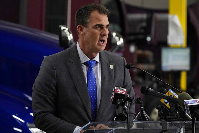Oklahoma Gov. Kevin Stitt speaks during a news conference, Monday, May 17, 2021, in Oklahoma City. Oklahoma will end a $300-a-week federal supplemental unemployment benefit next month. (AP Photo/Sue Ogrocki)