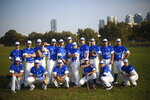In this Tuesday, Jan. 14, 2020 photo, Israel's national baseball team poses for a group photo at a team practice in Tel Aviv, Israel. Team Israel's improbable run to the Tokyo Olympic Games is spurring hope that it will provide the overlooked sport of baseball in Israel its long-awaited boost. Baseball is returning to the Olympics after being dropped for 2012 and 2016 and Israel is one of six teams vying for the three medals. (AP Photo/Ariel Schalit)