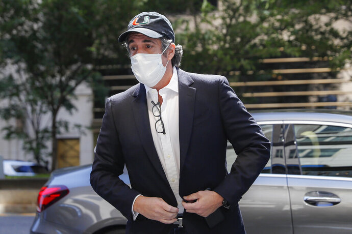 "FILE- In this May 21, 2020 file photo, Michael Cohen arrives at his Manhattan apartment in New York after being furloughed from prison because of concerns over the coronavirus. A bound edition about President Donald Trump's second impeachment will feature a foreword from an estranged associate _ former Trump attorney Michael Cohen. Skyhorse Publishing announced that ""The Second Impeachment Report"