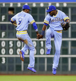 Seattle Mariners' Dee Gordon (9) and Guillermo Heredia celebrate after the Mariners' 5-2 win in a baseball game against the Houston Astros on Friday, Aug. 10, 2018, in Houston. (AP Photo/David J. Phillip)
