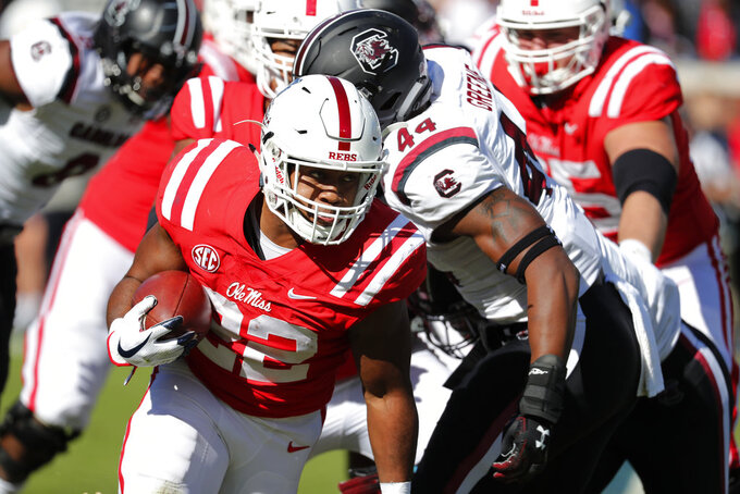 Mississippi running back Scottie Phillips (22) pushes past South Carolina linebacker Sherrod Greene (44) on his way to a long run during the first half of an NCAA college football game, Saturday, Nov. 3, 2018, in Oxford, Miss. (AP Photo/Rogelio V. Solis)