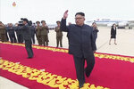 In this image made from video released by KRT on June 14, 2018, shows North Korean leader Kim Jong Un waves to hundreds of well-wishers as he returns to a grand red carpet welcoming following his summit with U.S. President Donald Trump, June 12, 2018. North Koreans are getting a new look at U.S. President Donald Trump now that his summit with leader Kim Jong Un is safely over and it's a far cry from the