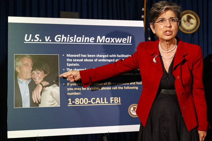 "FILE- In this July 2, 2020 file photo, Audrey Strauss, Acting United States Attorney for the Southern District of New York, points to a photo of Jeffrey Epstein and his ex-girlfriend Ghislaine Maxwell. Sex trafficking charges were added Monday, March 29, 2021 to the indictment against financier Jeffrey Epstein's ex-girlfriend as prosecutors alleged that she groomed a 14-year-old girl to recruit other young females in the early 2000s to provide ""sexualized massages"" to Epstein in return for cash. (AP Photo/John Minchillo, File)"
