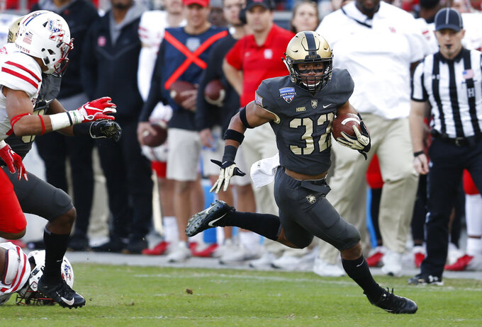 Army running back Artice Hobbs IV (32) carries the ball against Army during the first half of Armed Forces Bowl NCAA college football game Saturday, Dec. 22, 2018, in Fort Worth, Texas. (AP Photo/Jim Cowsert)