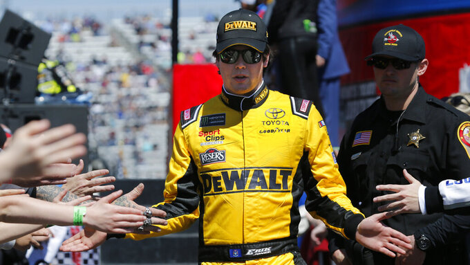 NASCAR Cup Series driver Erik Jones (20) greets fans during driver introductions prior to the NASCAR Cup Series auto race at the Martinsville Speedway in Martinsville, Va., Sunday, March 24, 2019. (AP Photo/Steve Helber)