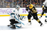 Boston Bruins' Brad Marchand looks for a rebound off a save by San Jose Sharks goaltender Martin Jones during the first period of an NHL hockey game, Tuesday, Oct. 29, 2019, in Boston. (AP Photo/Winslow Townson)