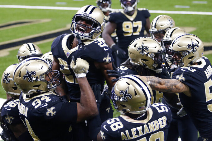 New Orleans Saints players hoist cornerback Patrick Robinson (21) after his late game interception in the end zone in the second half of an NFL football game against the San Francisco 49ers in New Orleans, Sunday, Nov. 15, 2020. The Saints won 27-13. (AP Photo/Brett Duke)