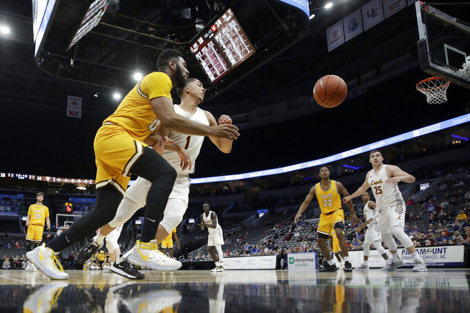 Valparaiso's Eron Gordon, left, and Loyola of Chicago's Lucas Williamson (1) reach for a loose ball during the first half of an NCAA college basketball game in the quarterfinal round of the Missouri Valley Conference men's tournament Friday, March 6, 2020, in St. Louis. (AP Photo/Jeff Roberson)