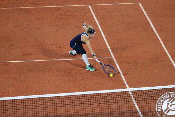 Germany's Laura Siegemund plays a shot against France's Kristina Mladenovic in the first round match of the French Open tennis tournament at the Roland Garros stadium in Paris, France, Tuesday, Sept. 29, 2020. (AP Photo/Michel Euler)