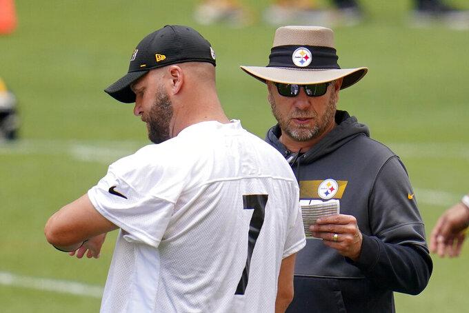 Pittsburgh Steelers quarterback Ben Roethlisberger (7) and offensive coordinator Matt Canada talk during the team's NFL mini-camp football practice in Pittsburgh, Tuesday, June 15, 2021. (AP Photo/Gene J. Puskar)