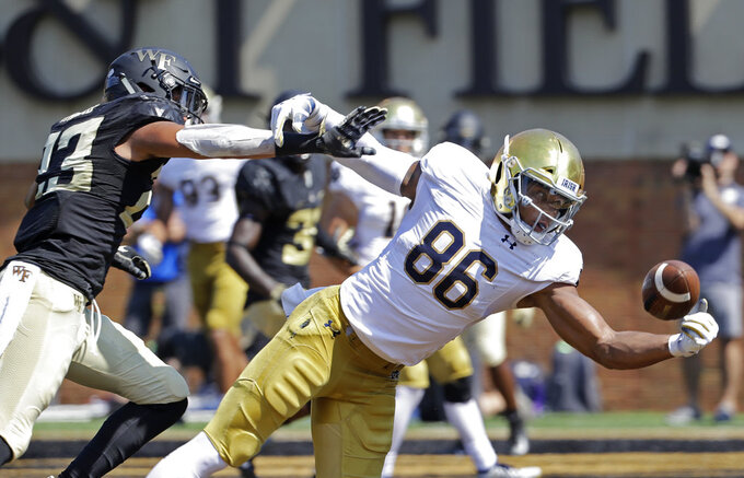 Notre Dame's Alize Mack (86) reaches for a pass as Notre Dame's Drue Tranquill (23) defends in the first half of an NCAA college football game in Winston-Salem, N.C., Saturday, Sept. 22, 2018. The pass was incomplete. (AP Photo/Chuck Burton)