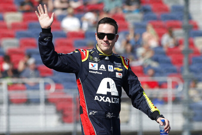 Alex Bowman during driver introductions prior to the NASCAR Cup Series auto race at ISM Raceway, Sunday, Nov. 10, 2019, in Avondale, Ariz. (AP Photo/Ralph Freso)