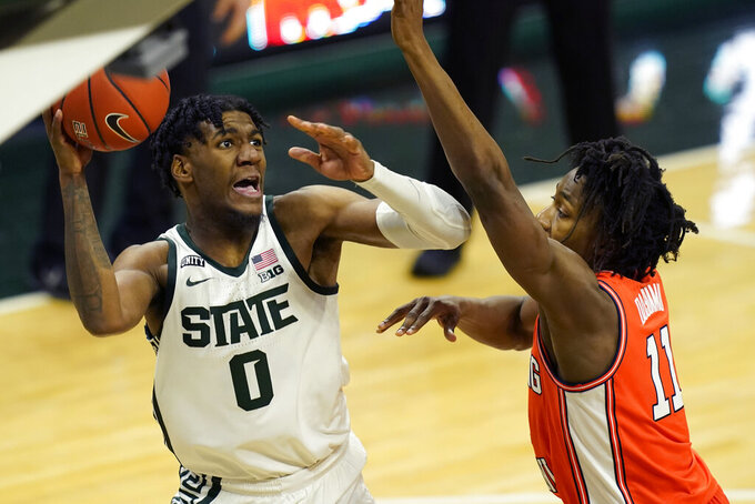 Michigan State forward Aaron Henry (0) looks to shoot as Illinois guard Ayo Dosunmu (11) defends during the second half of an NCAA college basketball game, Tuesday, Feb. 23, 2021, in East Lansing, Mich. (AP Photo/Carlos Osorio)