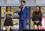 Natalie Portman, from left, Chris Hemsworth and Tessa Thompson participate during the