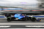 Williams driver George Russell of Britain steers his car during the qualifying session at the Sochi Autodrom circuit, in Sochi, Russia, Saturday, Sept. 25, 2021. The Russian Formula One Grand Prix will be held on Sunday. (Yuri Kochetkov/Pool Photo via AP)