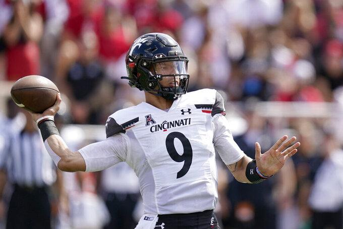 Cincinnati quarterback Desmond Ridder (9) throws during the first half of an NCAA college football game against Indiana, Saturday, Sept. 18, 2021, in Bloomington, Ind. (AP Photo/Darron Cummings)