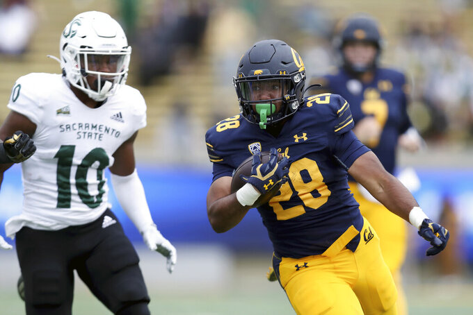 California running back Damien Moore (28) runs against Sacramento State safety Malik Jeter (10) during the second half of an NCAA college football game on Saturday, Sept. 18, 2021, in Berkeley, Calif. (AP Photo/Jed Jacobsohn)