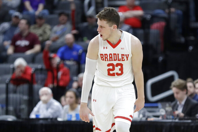 Bradley's Ville Tahvanainen celebrates after making a 3-point basket during the second half of an NCAA college basketball game against Southern Illinois in the quarterfinal round of the Missouri Valley Conference men's tournament Friday, March 6, 2020, in St. Louis. (AP Photo/Jeff Roberson)