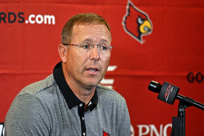 Louisville head coach Scott Satterfield speaks during the NCAA college football team's media day in Louisville, Ky., Saturday, Aug. 14, 2021. (AP Photo/Timothy D. Easley)