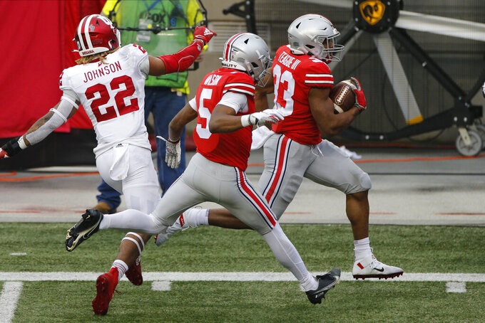 Ohio State running back Master Teague, right, runs up the sidelines to score a touchdown against Indiana during the first half of an NCAA college football game Saturday, Nov. 21, 2020, in Columbus, Ohio. (AP Photo/Jay LaPrete)