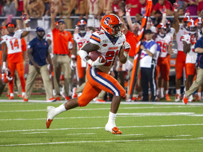 Syracuse running back Moe Neal breaks free to score a touchdown during the second half against Liberty in an NCAA college football game in Lynchburg, Va. Saturday, Aug. 31, 2019. (AP Photo/Matt Bell)/Danville Register & Bee via AP)