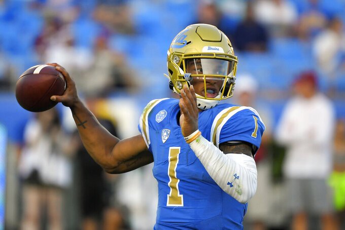 UCLA quarterback Dorian Thompson-Robinson looks for a receiver during the first half of the team's NCAA college football game against Oklahoma on Saturday, Sept. 14, 2019, in Pasadena, Calif. (AP Photo/Mark J. Terrill)