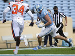 North Carolina's Garrett Walston (84) scores on a pass from quarterback Sam Howell in the first quarter of an NCAA college football game against Syracuse Saturday, Sept. 12, 2020 in Chapel Hill, N.C. (Robert Willett/The News & Observer via AP, Pool)