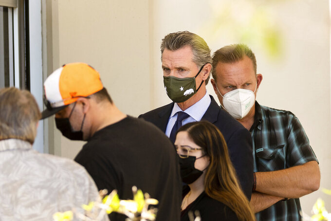 California Gov. Gavin Newsom leaves a staging area for Santa Clara Valley Transportation Authority (VTA) workers, family members and officials following a shooting at one of the agency's rail yards on Wednesday, May 26, 2021, in San Jose, Calif. A Santa Clara County sheriff's spokesman said the shooting left at least eight people, including the gunman, dead. (AP Photo/Noah Berger)