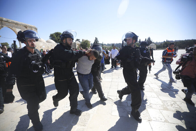 Israeli police arrests a Palestinian worshipper at al-Aqsa mosque compound in Jerusalem, Sunday, Aug 11, 2019.(AP Photo/Mahmoud Illean)