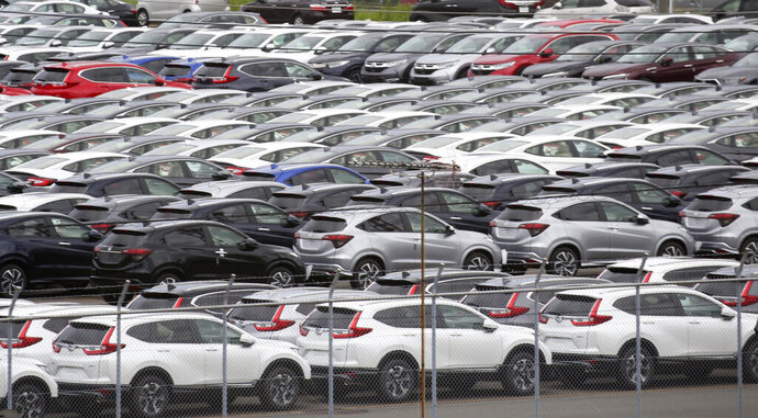 In this July 8, 2019, photo, Honda cars wait to be exported at Yokohama port, near Tokyo. Honda recorded a 6.7% decline in July-September profit as vehicle and motorcycle sales slipped and an unfavorable exchange rate hurt earnings at the Japanese automaker, Honda Motor Co. reported Friday, Nov. 8, 2019. (AP Photo/Koji Sasahara)