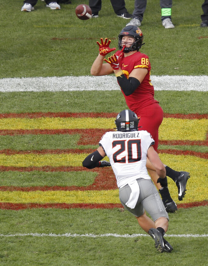 Iowa State tight end Charlie Kolar, top, pulls in a touchdown reception over Oklahoma State safety Malcolm Rodriguez during the first half of an NCAA college football game, Saturday, Oct. 26, 2019, in Ames, Iowa. (AP Photo/Matthew Putney)