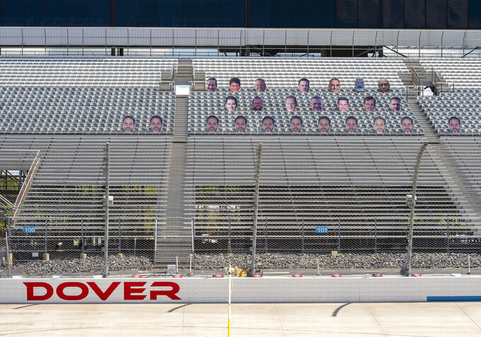 Cardboard faces in the seats during a NASCAR Xfinity Series auto race at Dover International Speedway, Sunday, Aug. 23, 2020, in Dover, Del. (AP Photo/Jason Minto)