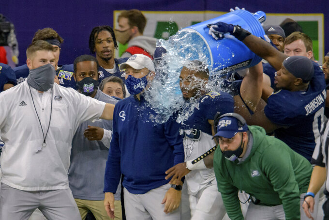 Georgia Southern coach Chad Lunsford gets doused as the team start to celebrate a victory over Louisiana Tech in the New Orleans Bowl NCAA college football game in New Orleans, Wednesday, Dec. 23, 2020. (AP Photo/Matthew Hinton)