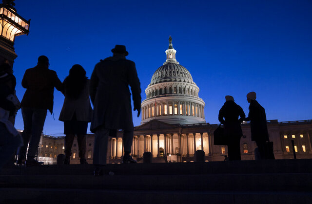 FILE - In this Jan. 22, 2020 file photo, night falls on the Capitol, in Washington. For many Americans, how they feel about issues raised during President Donald Trump's impeachment has much to do with where they get their news. That's among the findings of a study out Friday, Jan. 24,  by the Pew Research Center.   (AP Photo/J. Scott Applewhite, File)