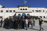 Algerian police forces stand guard outside the Bir Mourad Rais courthouse in Algiers, Monday, Nov.4, 2019 during a hand-over ceremony of a new prosecutor. Judges and prosecutors began an open-ended strike last Wednesday to demand the independence of the judiciary after a massive reshuffle that has affected thousands. (AP Photo/Fateh Guidoum)