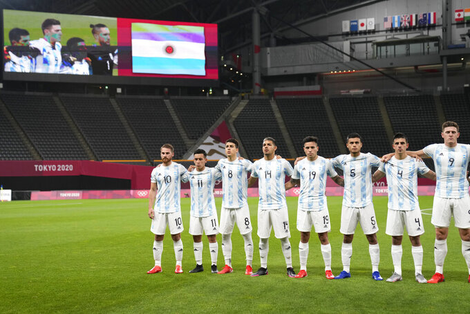Players of Argentina embrace prior to their men's soccer match against Australia at the 2020 Summer Olympics, Thursday, July 22, 2021, in Sapporo, Japan. (AP Photo/SIlvia Izquierdo)