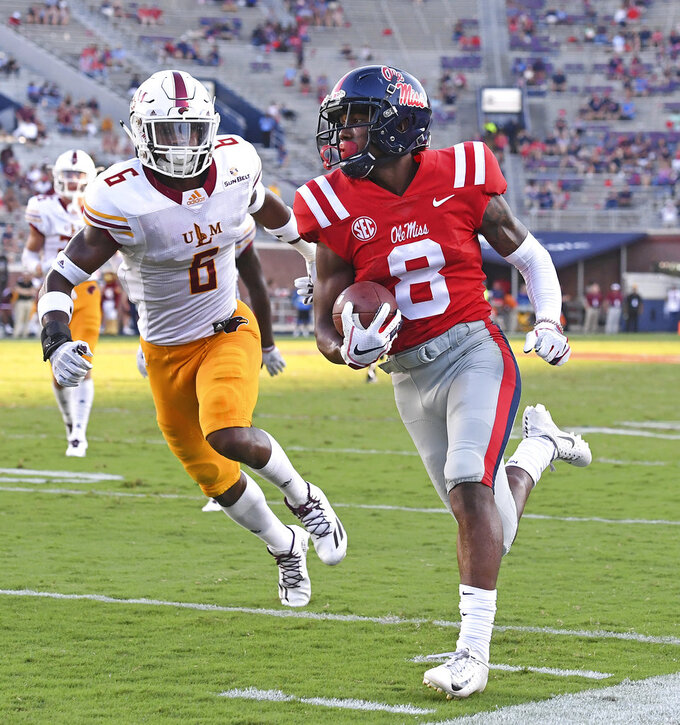 Mississippi wide receiver Elijah Moore (8) runs the ball past Louisiana Monroe safety Wesley Thompson (6) for a 24-yard touchdown catch during the second half of an NCAA college football game in Oxford, Miss., Saturday, Oct. 6, 2018. Mississippi won 70-21. (AP Photo/Thomas Graning)