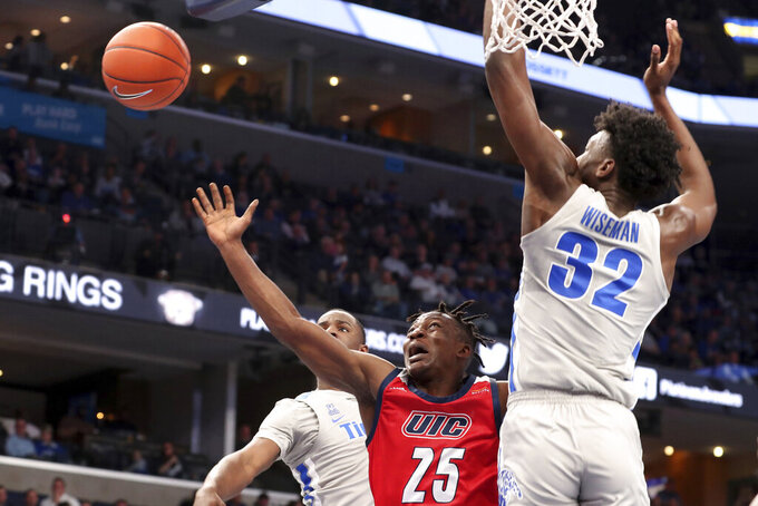 Memphis' James Wiseman (32) guards Illinois-Chicago's Godwin Boahen (25) during the first half of an NCAA college basketball game Friday, Nov. 8, 2019, in Memphis, Tenn. (AP Photo/Karen Pulfer Focht)