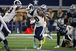 Los Angeles Rams running back Todd Gurley (30) carries for a short gain in the second half of an NFL football game against the Dallas Cowboys in Arlington, Texas, Sunday, Dec. 15, 2019. (AP Photo/Michael Ainsworth)