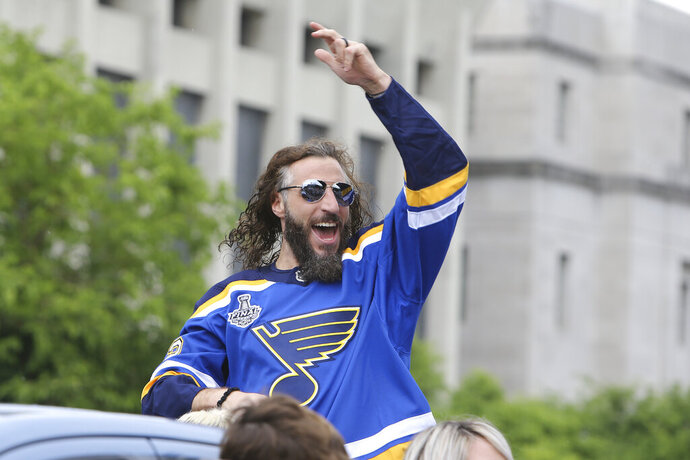 In this  June 15, 2019 file photo St. Louis Blues right wing Chris Thorburn waves to fans during the NHL hockey Stanley Cup victory celebration in St. Louis. Thorburn has announced his retirement, Monday, June 22, 2020 after playing more than 800 NHL games since 2005. Thorburn spent his last time on the ice celebrating the St. Louis Blues winning the Stanley Cup last season. (AP Photo/Scott Kane, file)